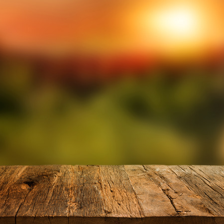 square background: Wooden deck table over beautiful autumn background