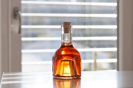 Brandy in a beautiful bottle in front of modern background