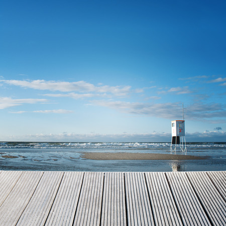 SEA  LANDSCAPE: Landscape of a wooden jetty overlooking the sea with a sunny background