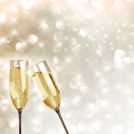 Toasting with champagne glasses very festive background