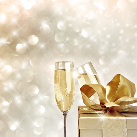 spiegelung: Toasting with champagne glasses very festive background with christmas gift Stock Photo
