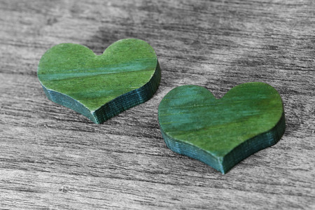holz: Two green hearts on a wooden background Stock Photo