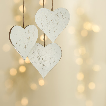 Three hearts on a Christmas background