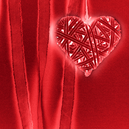 harmonie: Braided heart on red background paper Stock Photo