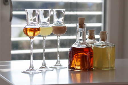 farbe: Brandy in three glasses in front of modern background Stock Photo