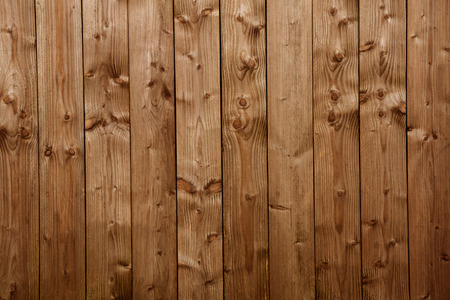 hintergrund: An old brown wooden wall with vertical boards Stock Photo
