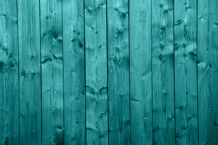 muster: An old turquoise wooden wall with vertical boards