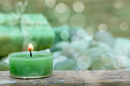 relaxation background: Close Up of natural herbal soap with candlelight
