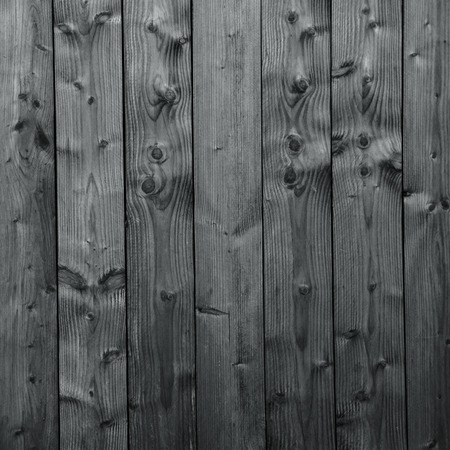 An old gray wooden wall with vertical boards