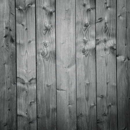 holz: An old gray wooden wall with vertical boards