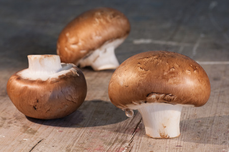 gourmet kitchen: Close up of mushrooms on a rustic chopping board.