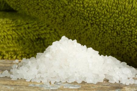 bath salts: Spa scene with white bath salts and green towels