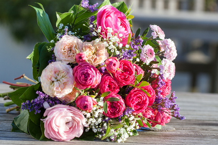 zest for life: Romantic bouquet with pink roses in the garden Stock Photo
