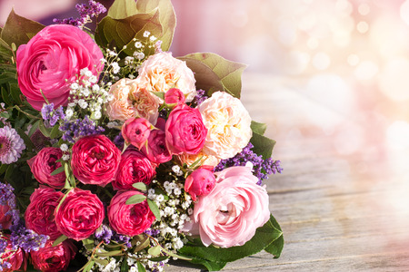WEDDING DAY: Romantic bouquet with pink roses on a vintage background Stock Photo