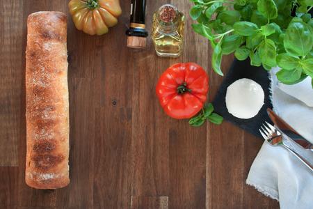 ciabatta: Ciabatta with tomatoes, mozzarella, basil, olive oil and balsamic Stock Photo
