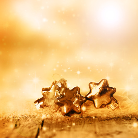 Wintry background with golden christmas stars Stock Photo