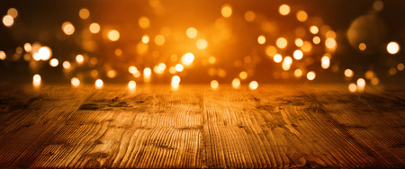 Christmas Bokeh background with empty wooden table