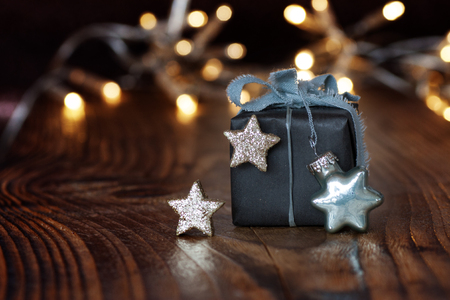 silver stars: Christmas gift with silver stars and a string of lights