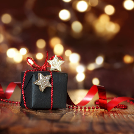 Very beautiful Christmas package in front of Starlights with bokeh