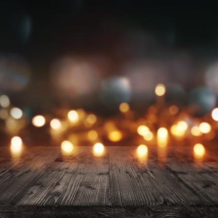 Fond avec des lumières pour les événements festifs devant une table en bois Banque d'images - 63841695