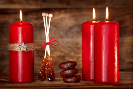Still life with candles for the Advent season on a wooden table