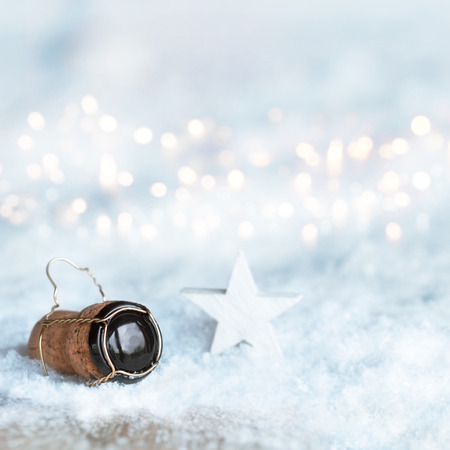 christmas motif: Winter motif for Christmas with a star and a champagne cork in the snow
