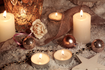 christmas motif: Christmas motif with candles on snow