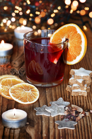 Mulled wine with orange and spices on a Christmas market in the evening