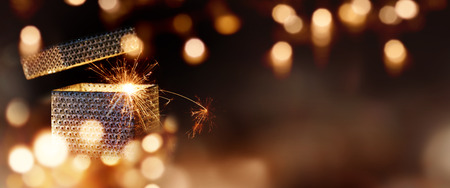 Magical gift parcel in a Panorama with golden lights and bokeh