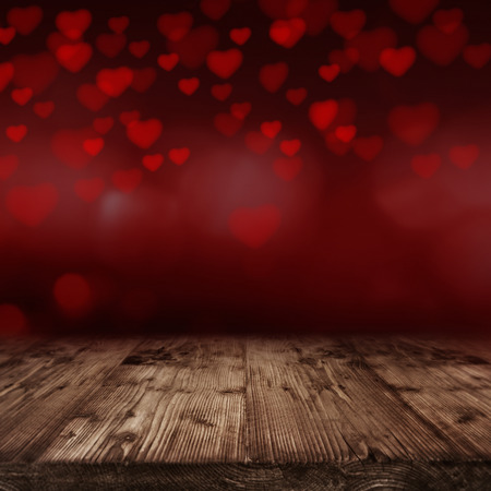 Valentines day background with many red Hearts in front of an empty wooden table Standard-Bild