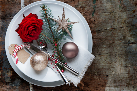 Romantic Christmas decoration for a dinner in a rustic style Stock Photo