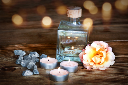 perfumed candle: Spa still life on wood table with bokeh for a concept