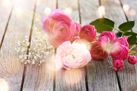 osterfest: Flower decoration on a wooden table in the spring sun with bokeh Stock Photo