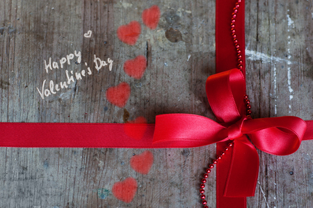 Background in shabby chic style with red bow and hearts for Valentines Day