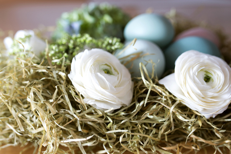 eastertime: Still life with easter eggs and flowers for a greeting card