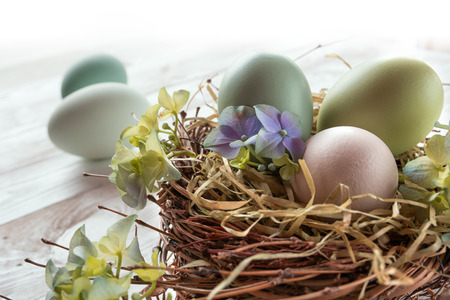 eastertime: Delicate still life with easter eggs in a nest Stock Photo