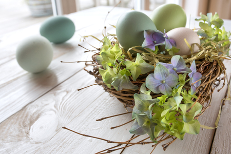eastertime: Still life for easter on a white wooden table in a room