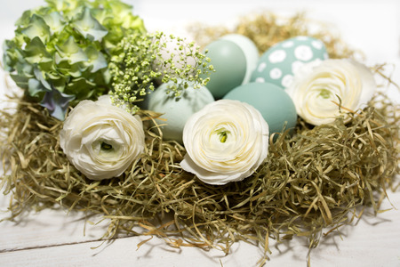 eastertime: Tender easter decoration with pastel colored eggs and flowers in vintage style Stock Photo