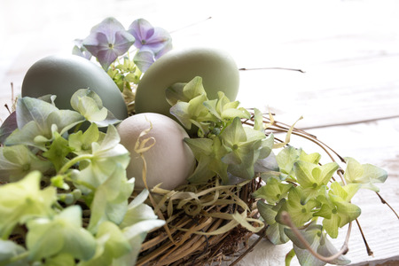 eastertime: Tender still life with easter eggs in a nest in vintage style Stock Photo