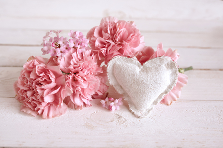 Pink flower decoration with a heart in vintage style for mothers day and wedding Stock Photo