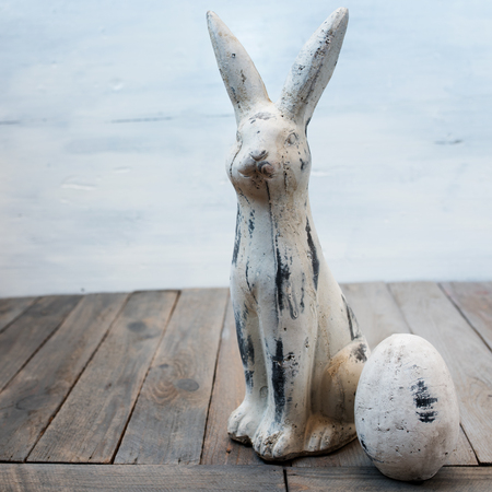 eastertime: Easter decoration with bunny and egg in shabby chic style close up