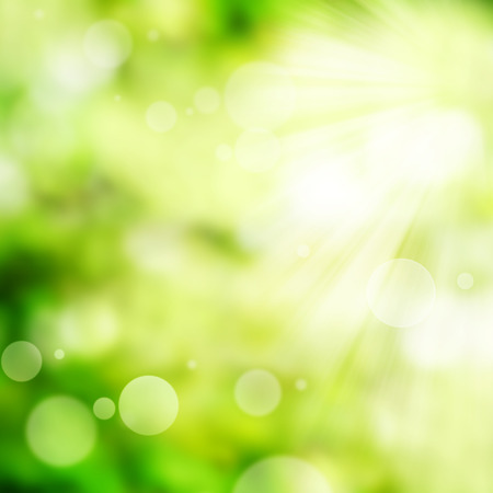Bright green spring background with bokeh effects Stock Photo
