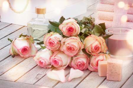 Spa products handmade aromatic soaps, oil and roses beautifully arranged in the spa area