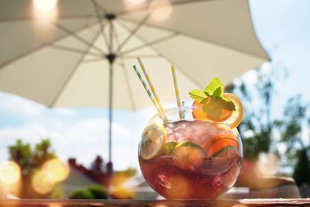 field mint: Fresh sangria punch on a summer terrace under a sun umbrella