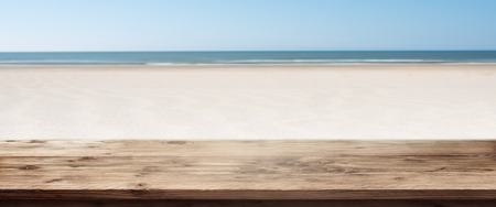 Beach panorama in summer with empty wooden table for a concept