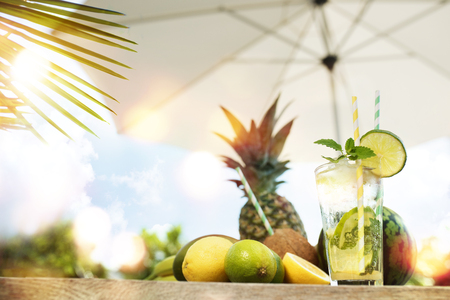 melon field: Caipirinha cocktail with exotic fruits on a terrace in summer