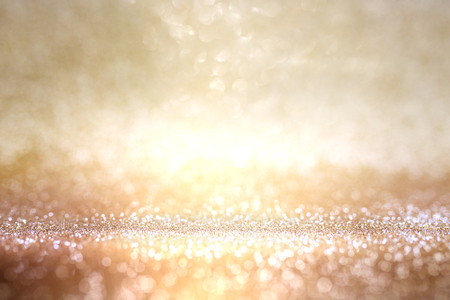 Abstract background in dark gold and silver with bright bokeh effects for a celebratory concept