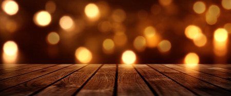 Christmas golden bokeh background with empty wooden table for a decoration Stock Photo