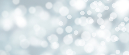 Abstract silver bokeh background with snowfall at wintertime Stock Photo