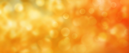 Abstract gold and orange luminous autumn background with bokeh effect